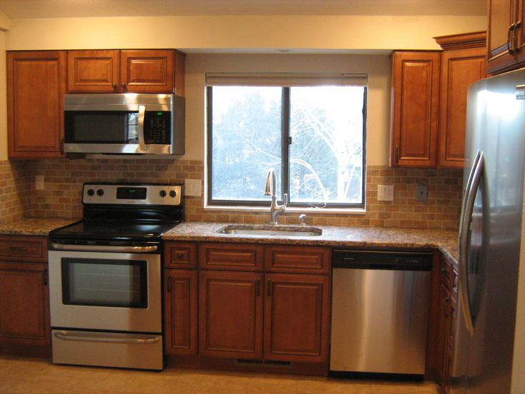 Appliances: Frigidaire counter depth frig, Frigidaire self cleaning glass top stove, LG OTR microwave, Amana dishwasher