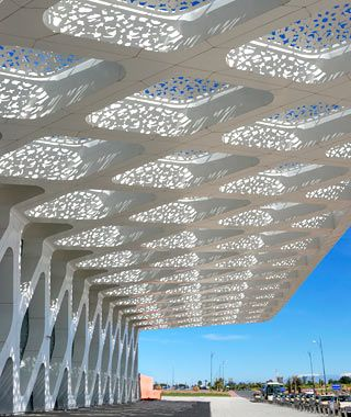 """Marrakech Menara Airport, Morocco    """"Completed in 2008, the structure is formed of massive concrete rhombuses. This muscular approach is softened by the exquisite arabesque patterns on the building's glass skin, which cast complex, ever-changing shadows on the terminal's floors."""""""