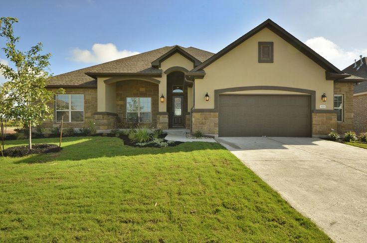 This custom one story ranch house plans features a for Exterior ranch home designs