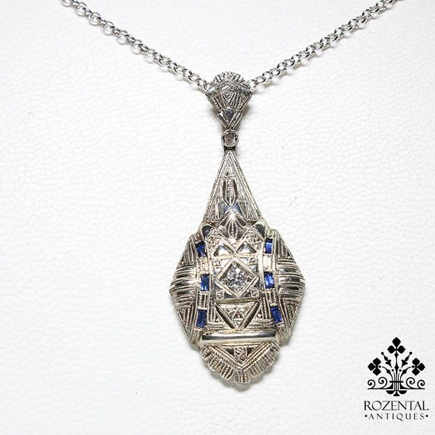 Period: Art deco (1920-1935) Composition: 18K White Gold Stones: - 1 Old mine cut diamond of H-VS2 quality that weighs 0.15ctw. - 6 Natural baguette French cut sapphires that weigh 0.30ctw. Measures: