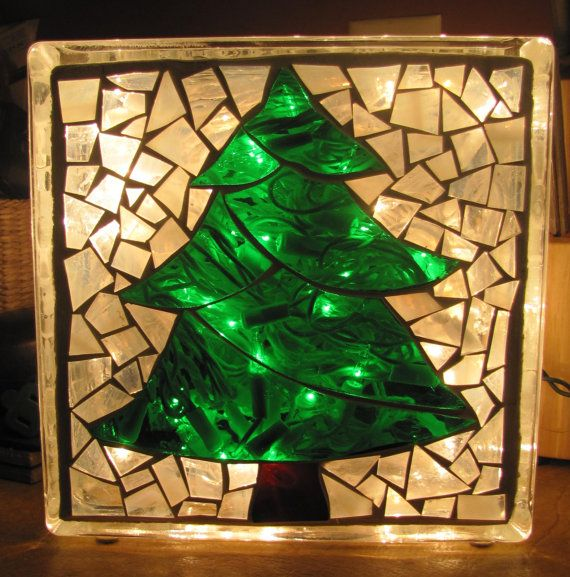 Mosaic stained glass on a decorative glass block. Block is lit with 100 mini white lights and has felt feet on the bottom.