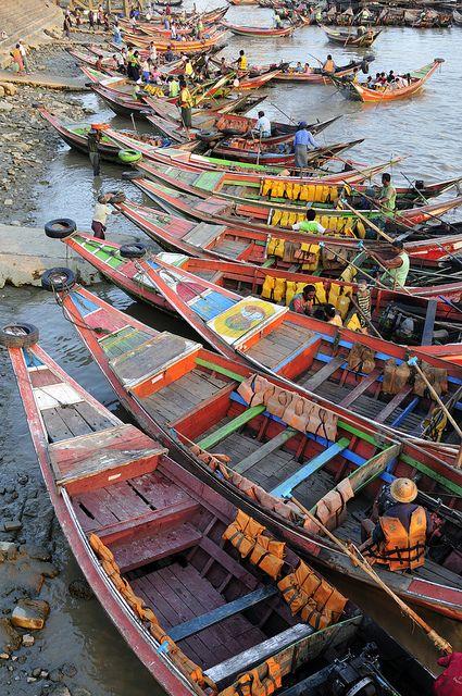 Rowboats moored in Irrawaddy River, Yangon Wharf, Myanmar // photo by Huang Xin