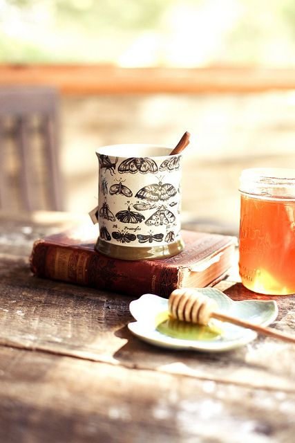 Tea with fresh honey & cinnamon sticks alongside a book for the perfect afternoon respite.