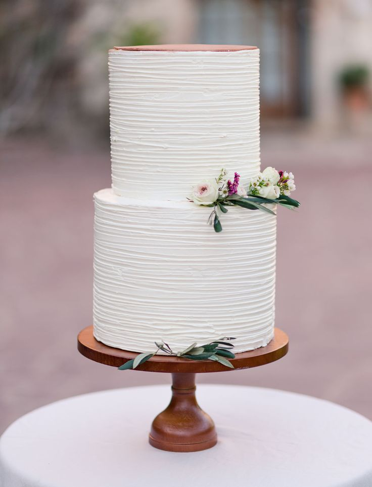 simple and modern white cake with rustic touches