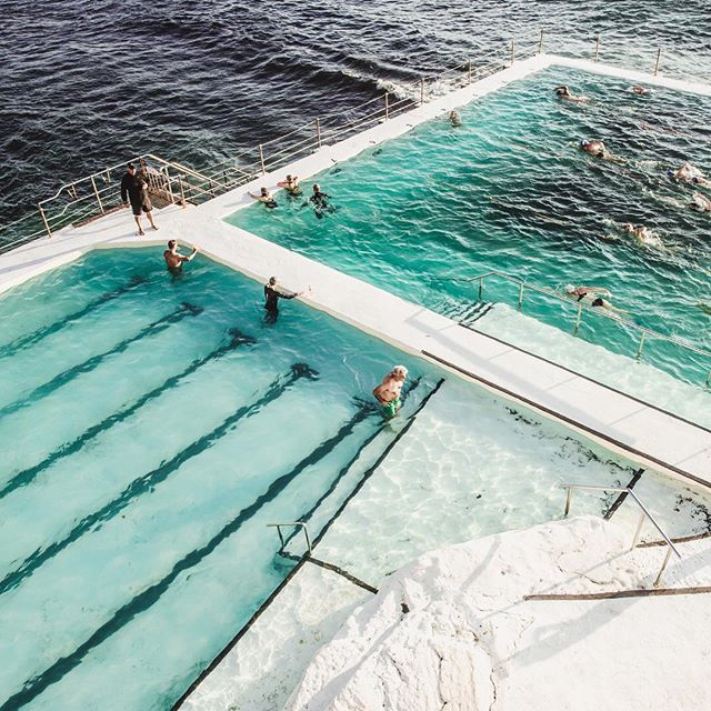 Aqua water, blue ocean, white rocks, and a swimming hole that's an Australian icon, it has to be the Bondi Icebergs Baths. This beautiful view from the top was captured by @rachaelbaskerville