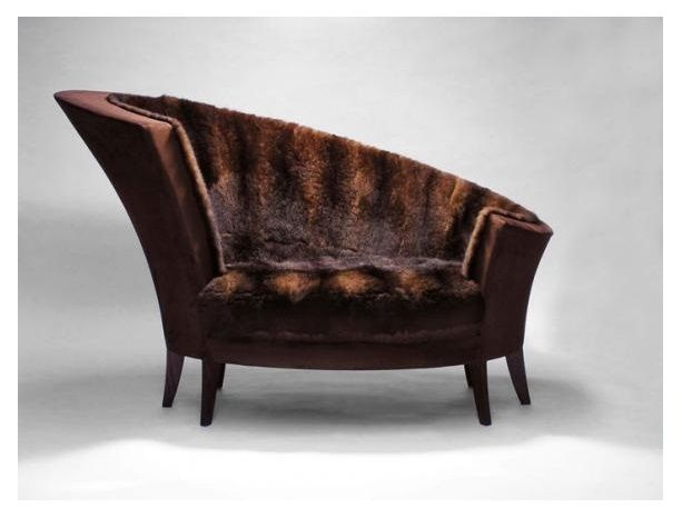 The Koru Chair by Cruikshank. Inspired by the joy of a little girl wrapped in a possum fur blanket, the Koru envelopes the sitter in its nest-like form. Only pelts of wild possum that have become a serious pest in New Zealand are used in the fur elements.
