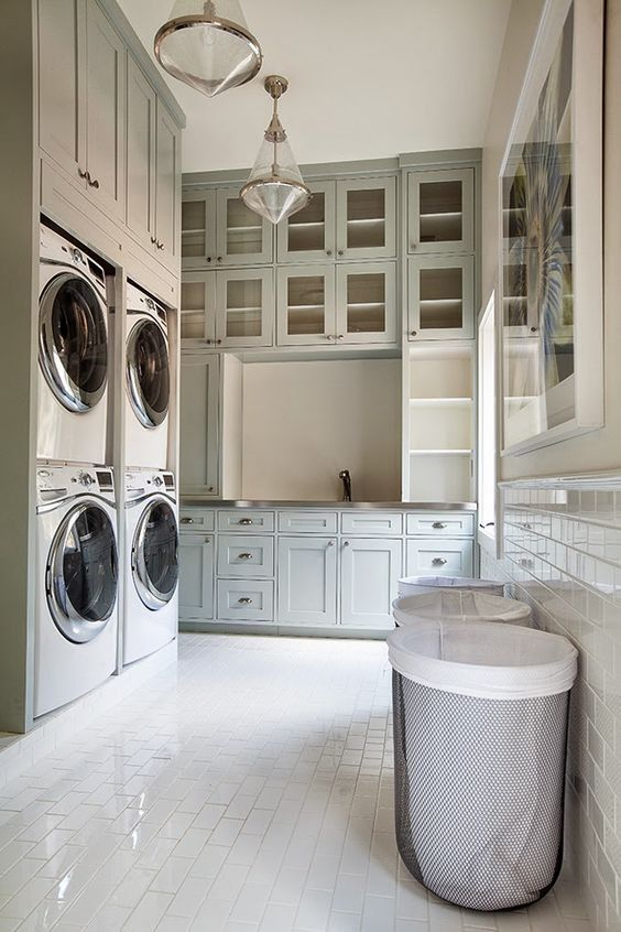 Amazing laundry room with TONS of cabinets and YES, dual washer and dryers.