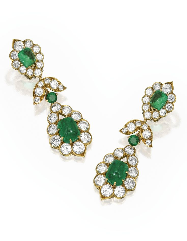 PAIR OF 18 KARAT GOLD, EMERALD AND DIAMOND PENDANT-EARCLIPS, VAN CLEEF & ARPELS. Suspending two sugarloaf cabochon emeralds weighing approximately 2.50 carats, topped by two round emeralds and two smaller sugarloaf cabochon emeralds weighing a total of approximately 4.50 carats, accented throughout with round diamonds weighing approximately 7.00 carats, signed V.C.A., numbered NY33608.