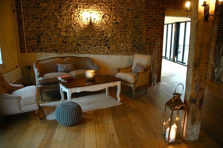 Flint Barn sofa area- hired in from #elizabethhalleventdesign #loungearea #lanterns #flintbarn