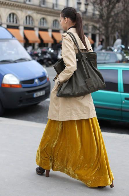 long skirt and a big bag