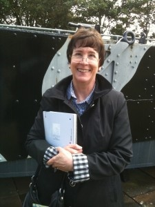Naomi at the Royal Marine Museum outside Portsmouth. She carries and protects her notebook in which she jots down ideas, phrases, observations, and information. She was working on the second book in the Witness series, The Mission. In this book she explores the trauma of grief as it affects the same characters who populated The Witness.