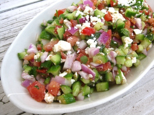 Summery Mediterranean Chopped Salad (Shepherd's Salad) with Cucumbers, Tomatoes, Red Onion, and Feta.