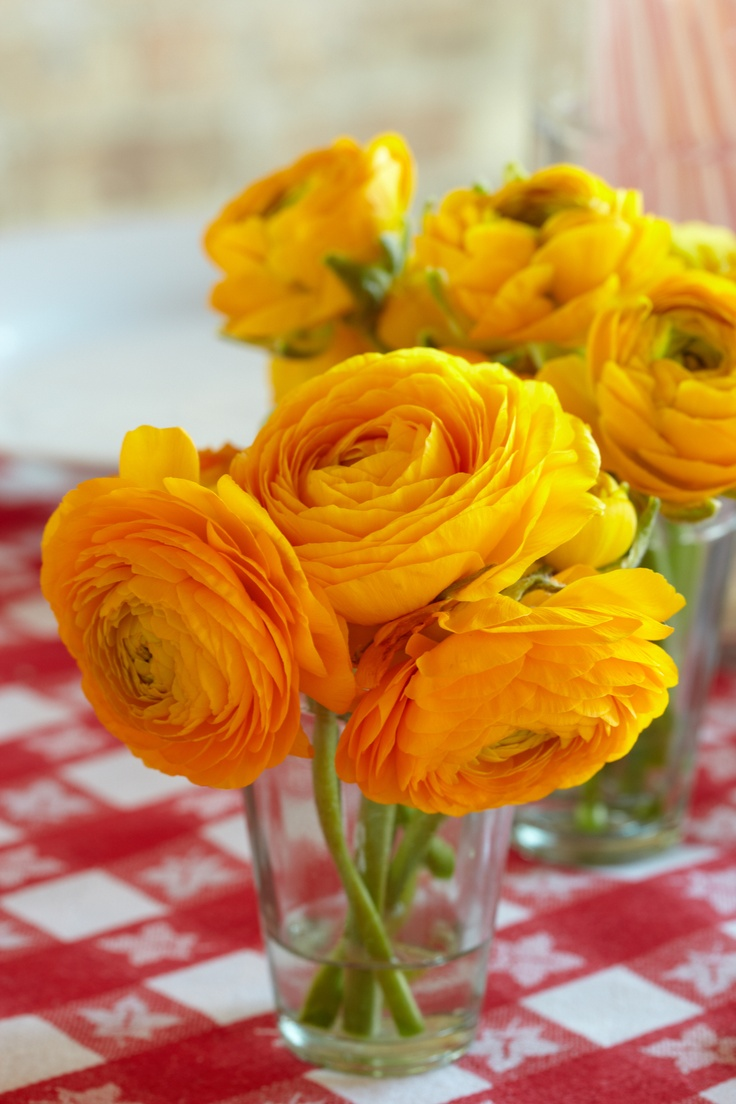 Flower Arrangements. Colorful flowers in simple drinking glasses go a long way in growing the baby shower theme.