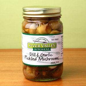 Dill & Garlic Pickled Mushrooms - White button mushrooms pickled in white vinegar with garlic cloves and fresh dill from our herb garden. Flavorful!