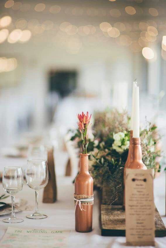 Make your  rustic decor feminine with some lace details and soft toned flowers