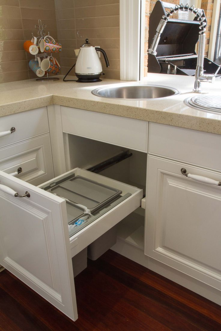 Under sink bin drawer. www.thekitchendesigncentre.com.au