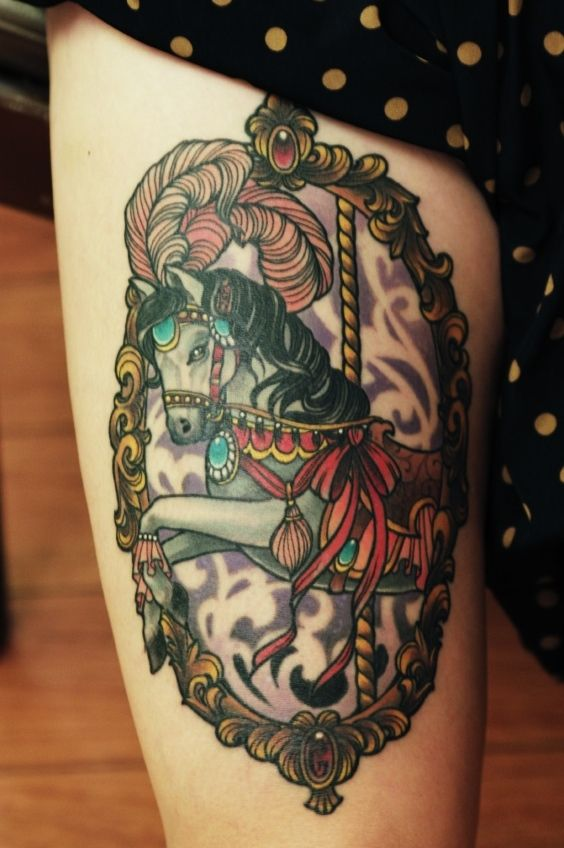 Seriously thinking about a thigh carousel tattoo like this.              Carousel tattoo done by Eilo Martin #carouselhorsetattoo #thightattoo