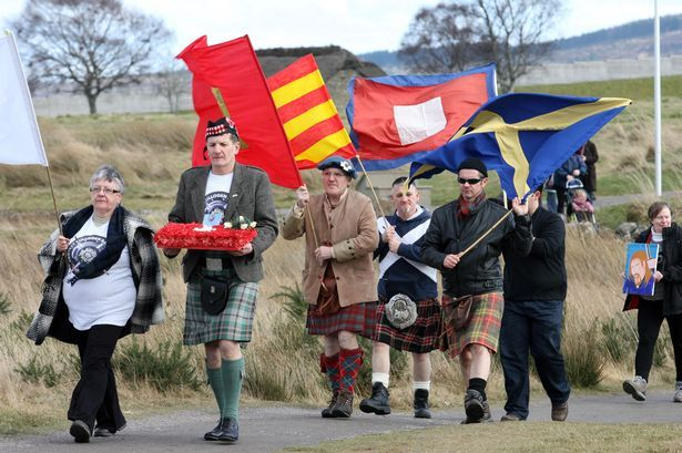 Kilted campaigners protest against plans to build houses 400 metres from Culloden battlefield - Daily Record