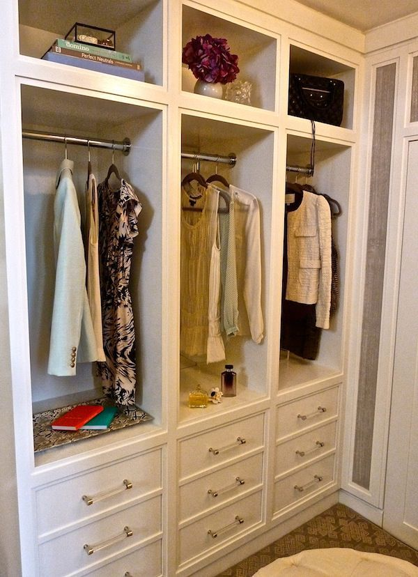 Paola Salinas, Kips Bay Showhouse: My design of a woman's dressing room embraces that ritual by creating an intimate space where any woman could relax, re-group & get ready. I believe in mixing high & low in design so while splurging on a custom chair, I kept costs down by building the cabinetry from MDF.