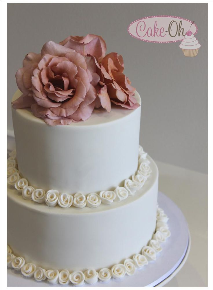 Ivory Wedding cake with sugar rosette decoration,