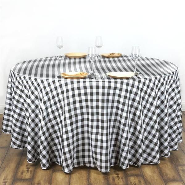 """White/Black 108"""" Round Checkered Gingham Polyester Picnic Tablecloth - Now you can relish that spring picnic feeling any time anywhere with our Perfect Picnic Inspired Checkered Polyester tablecloths. The inspiring and recreational checkered design brings back the memories of happy picnic times in gardens and by the river side. Create a peaceful and serene party ambiance with our luxury Polyester tablecloths fashioned in chic checkered design to exude positive energy and a classy look to…"""