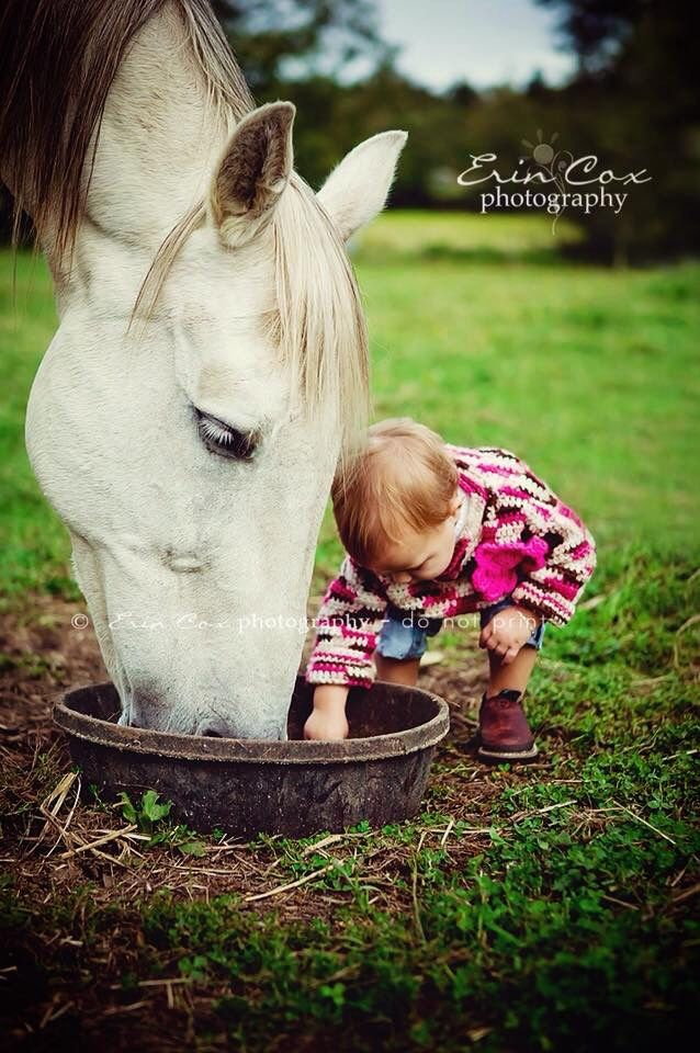 """""""That's yours and that one is mine."""" said the little girl to the great big horse as they are both picking around in his feed bowl! Cute horse photography!"""