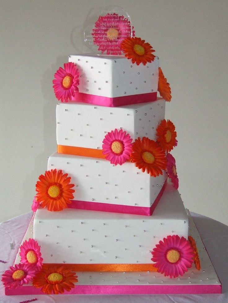 Gerbera Daisy Wedding Cake - Off-set square wedding cake covered in fondant with handmade gumpaste gerbera daisies.  TFL!