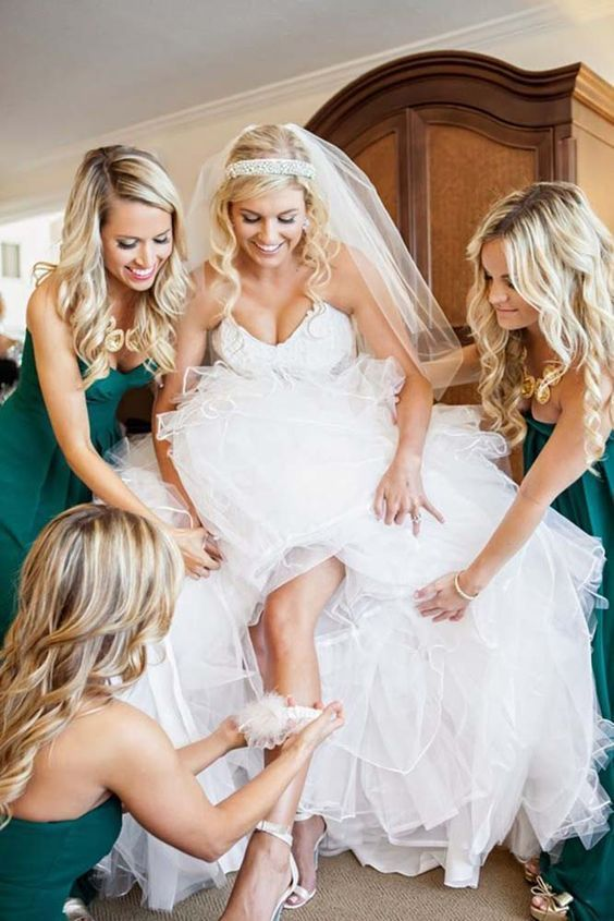 Getting ready wedding photos with your bridesmaids 8…