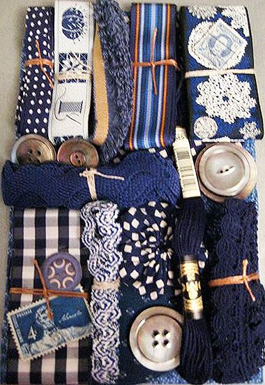 Collection of dark blue ribbons, trim, and other notions - reminds me of Sibella Court