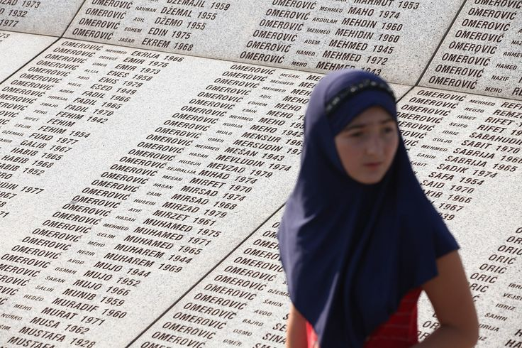 A young Muslim girl walks past a stone memorial bearing the names of victims of the 1995 Srebrenica massacre at the Potocari cemetery and memorial near Srebrenica on July 10, 2011 in Potocari, Bosnia and Herzegovina. Sean Gallup
