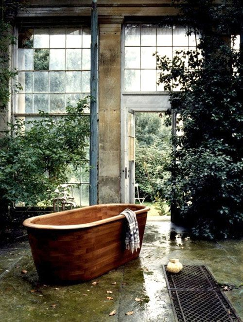 Bath: Wooden bathtub.