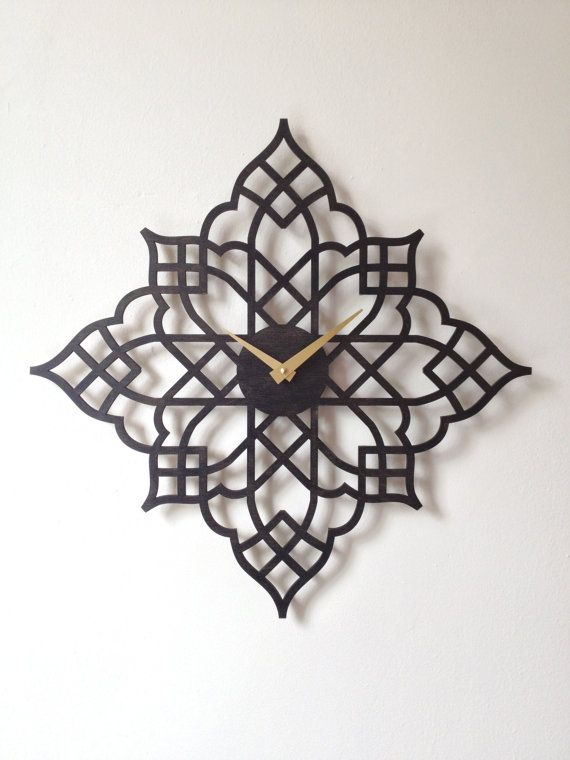 Each clock is made to order by Sarah Mimo, laser cut from premium baltic birch plywood, stained and finished by hand, and equipped with a high