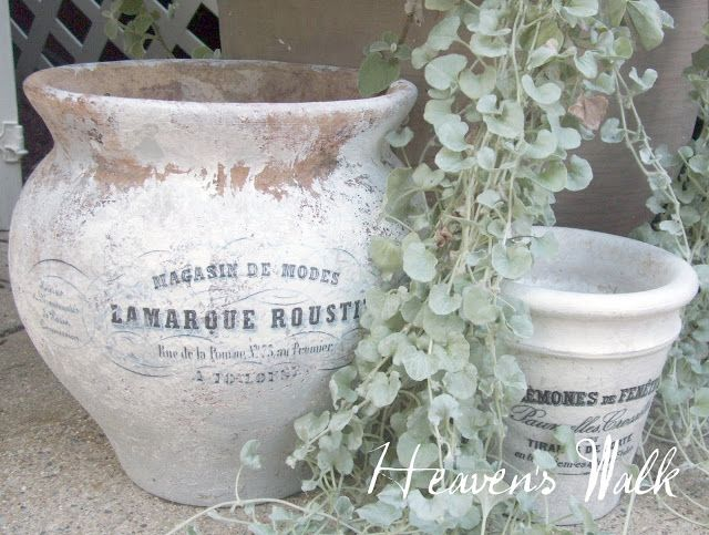 Great tutorial on how to make plain terra cotta flower pots looks old and French farmhouse chic by Laurie at Heaven's Walk - Click Through For Instructions.