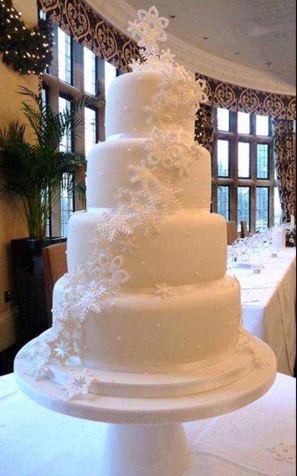 Snowflake wedding cake - with that skiing cake topper