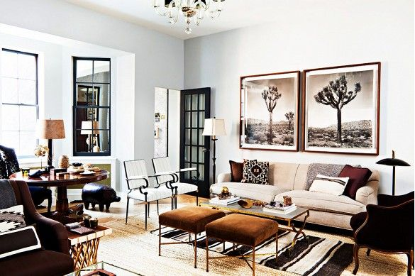 Layered living room with large scale Joshua Tree photography, vintage furniture, and striped kilim rug.