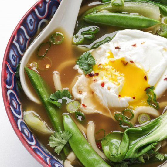 ... udon noodle soup with poached egg, sugar snap peas and bok choy is an