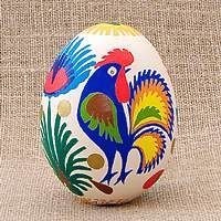A Polish egg created by glueing paper cut-outs to an egg