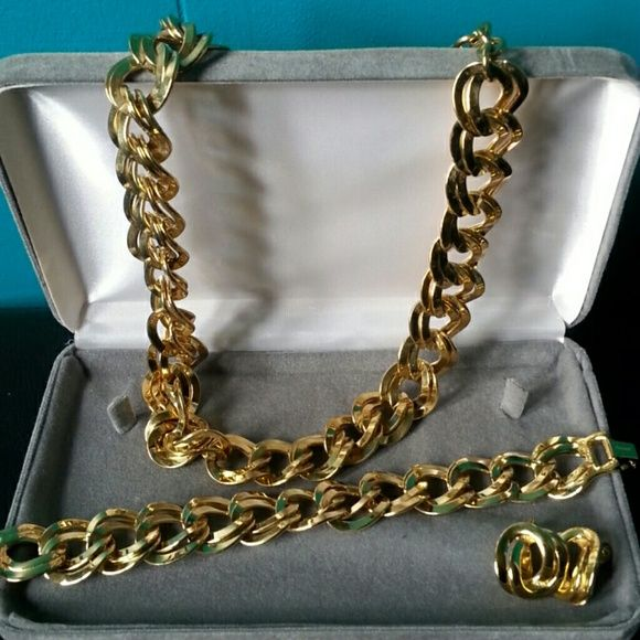 "☆BOGO50% Vintage Monet ""Debbie"" Double Link Vintage Monet ""Debbie"" Double Link Jewelry Set  Goldtone. Necklace, bracelet and clip-on earrings are all marked MONET (2nd pic) . Necklace shows a bit more signs of wear than the earrings and bracelet but I think it just needs some wiping with a soft jewelry cloth. There is a couple of dark spots on the necklace (pic 4 shows the biggest one)  hidden in between the links so it doesn't really show when wearing. Bracelet has one very tiny dark spot…"
