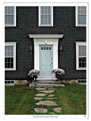 The more I see pictures of grey houses with pale/light turquoise doors, the more I like it!  I used to think about having a red door, but I'm so over it now... this blue manages to feel both modern and classic.