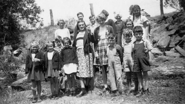 Koppio school students in 1952. Yes, one is holding a snake.
