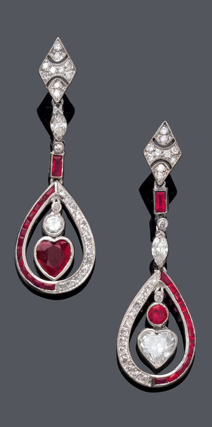 A PAIR OF ART DECO PLATINUM, WHITE GOLD, RUBY AND DIAMOND EAR PENDANTS, CIRCA 1920. Length 4 cm.