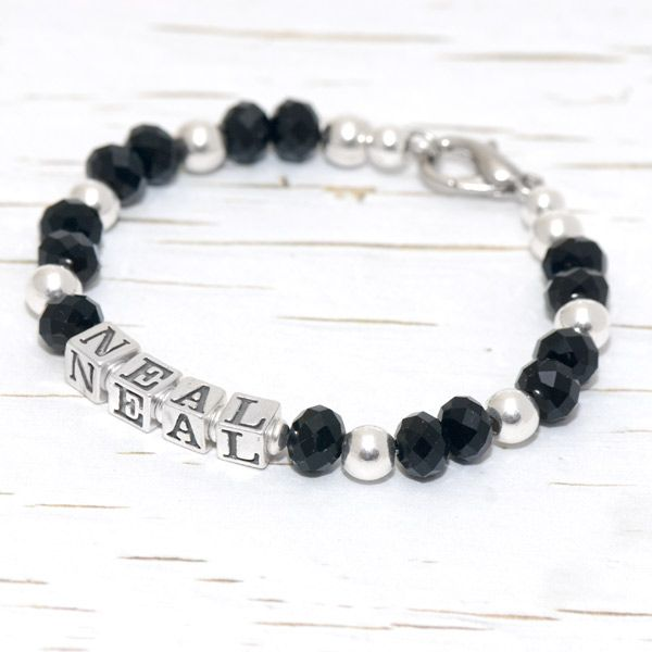 Caiseal is crafted with 6mm faceted Swarovski jet crystal and bright sterling silver beads, Caiseal is a very contemporary design. Personalise your bracelet with 4.5mm solid sterling silver letter cubes and add an optional extra charm(s) if you wish