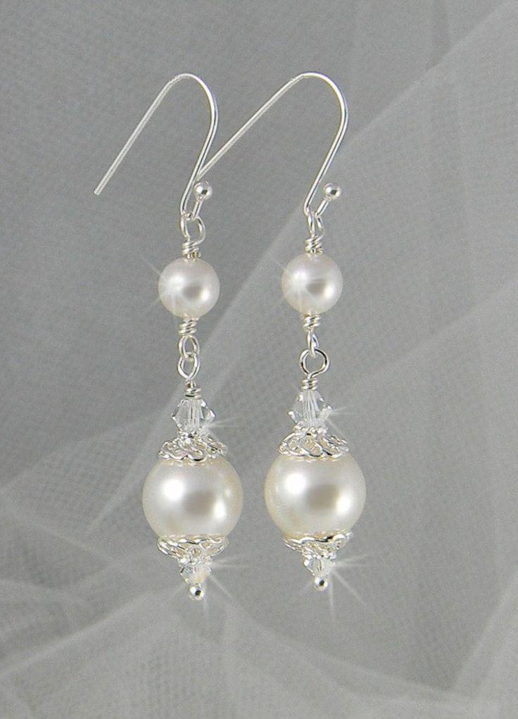 Bridal Earrings Long Dangle Pearl wedding earrings Swarovski Wedding jewelry, Swarovski Pearls, Swarovski Crystals, Abigail Earrings. $26.00, via Etsy.