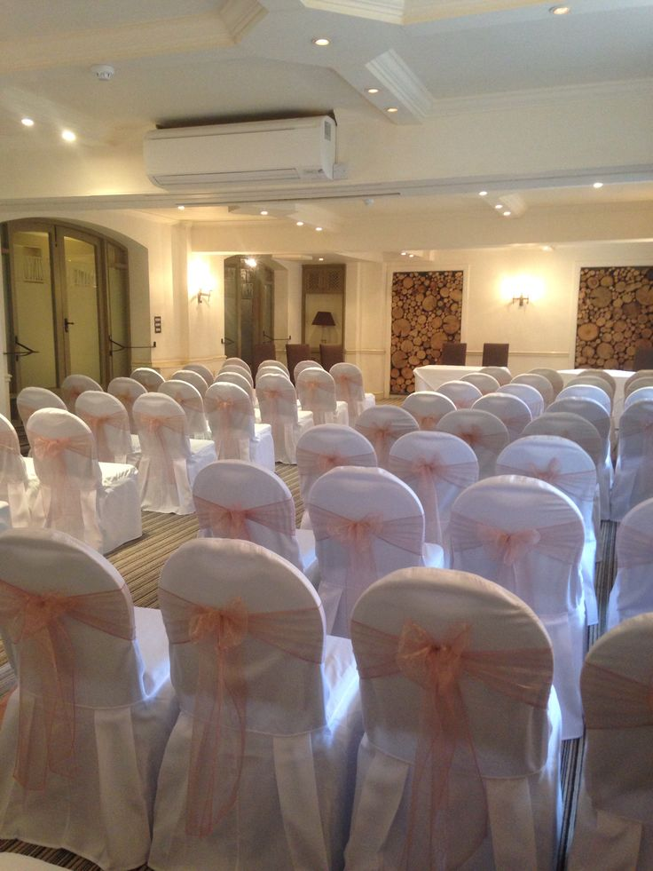 Chair covers with vintage pink sashes