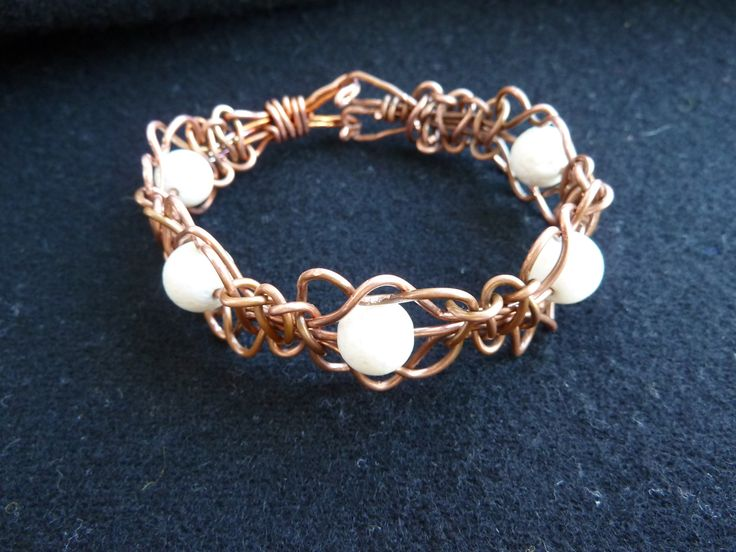Copper and white coral beads by   Florina Ravariu