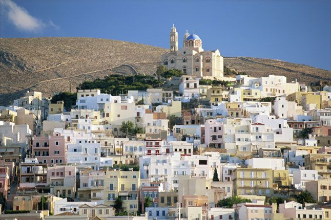 Despite its proud history, the Greek island of Syros, in the Cyclades, has fallen into an obscurity which has preserved its heritage, traditional cuisine and the genuine welcome offered by its people. As one of the few package-tour-free islands, it is essentially a self-contained society where tourists are guests, not an industry. #syros