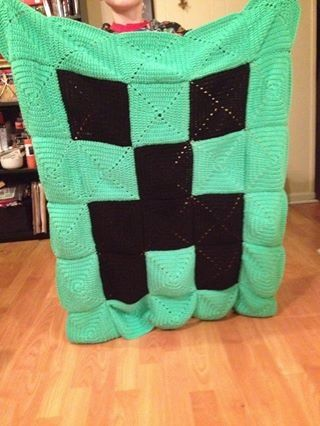 Minecraft blanket I crocheted for my son. Solid granny square pattern. Red Heart Glowworm and Black yarn used.