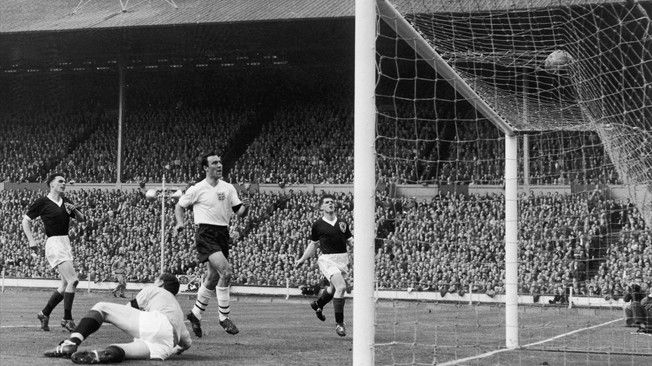 Jimmy Greaves scores England's third goal in the 9-3 rout of Scotland at Wembley in April 1961 in front of 97,000