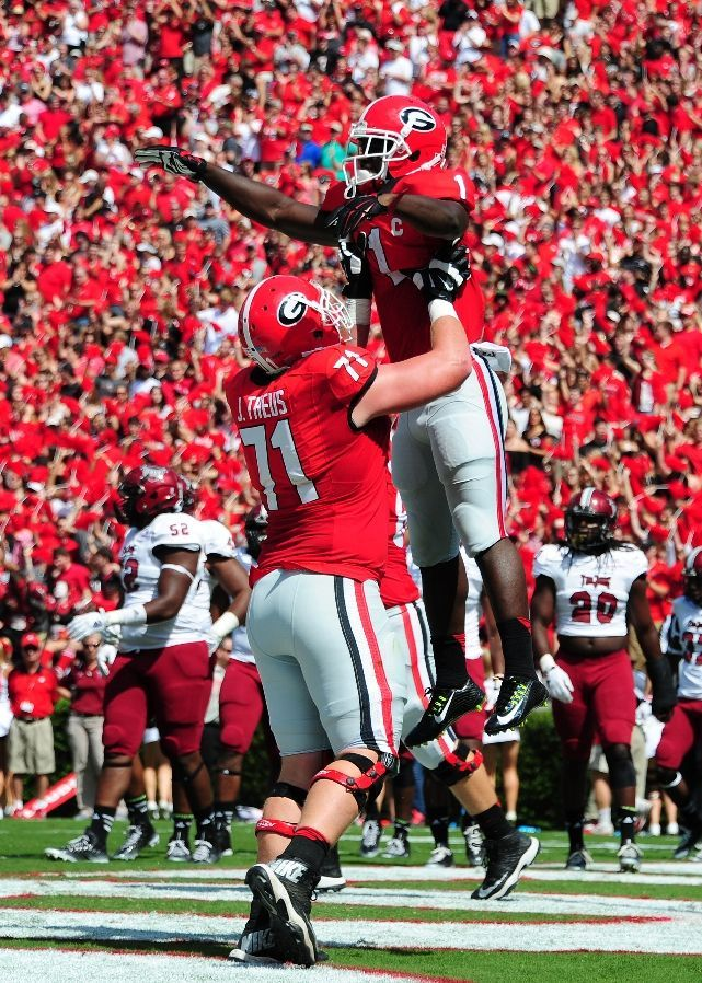 Georgia Football - Bulldogs Photos - ESPN THENS, GA - SEPTEMBER 20: Sony Michel #1 of the Georgia Bulldogs is hoisted by John Theus #71 after scoring a first quarter touchdown against the Troy Trojans at Sanford Stadium on September 20, 2014 in Athens, Georgia. (Photo by Scott Cunningham/Getty Images)