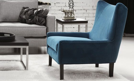 With a nod to mid-century modern design, yet very now, the Dakota chair shown here in peacock blue fabric is ideal for your living space. Made in Montreal.
